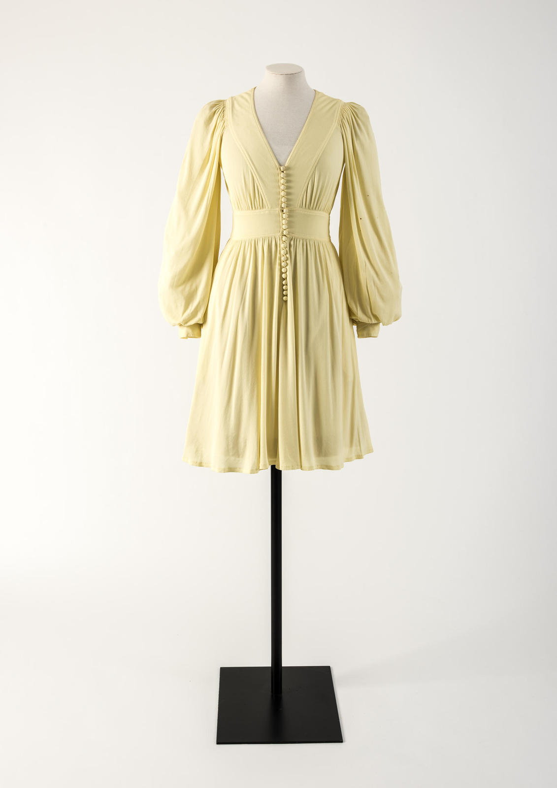 Lemon yellow rayon jersey dress with row of domed buttons. Jean Muir, 1974
