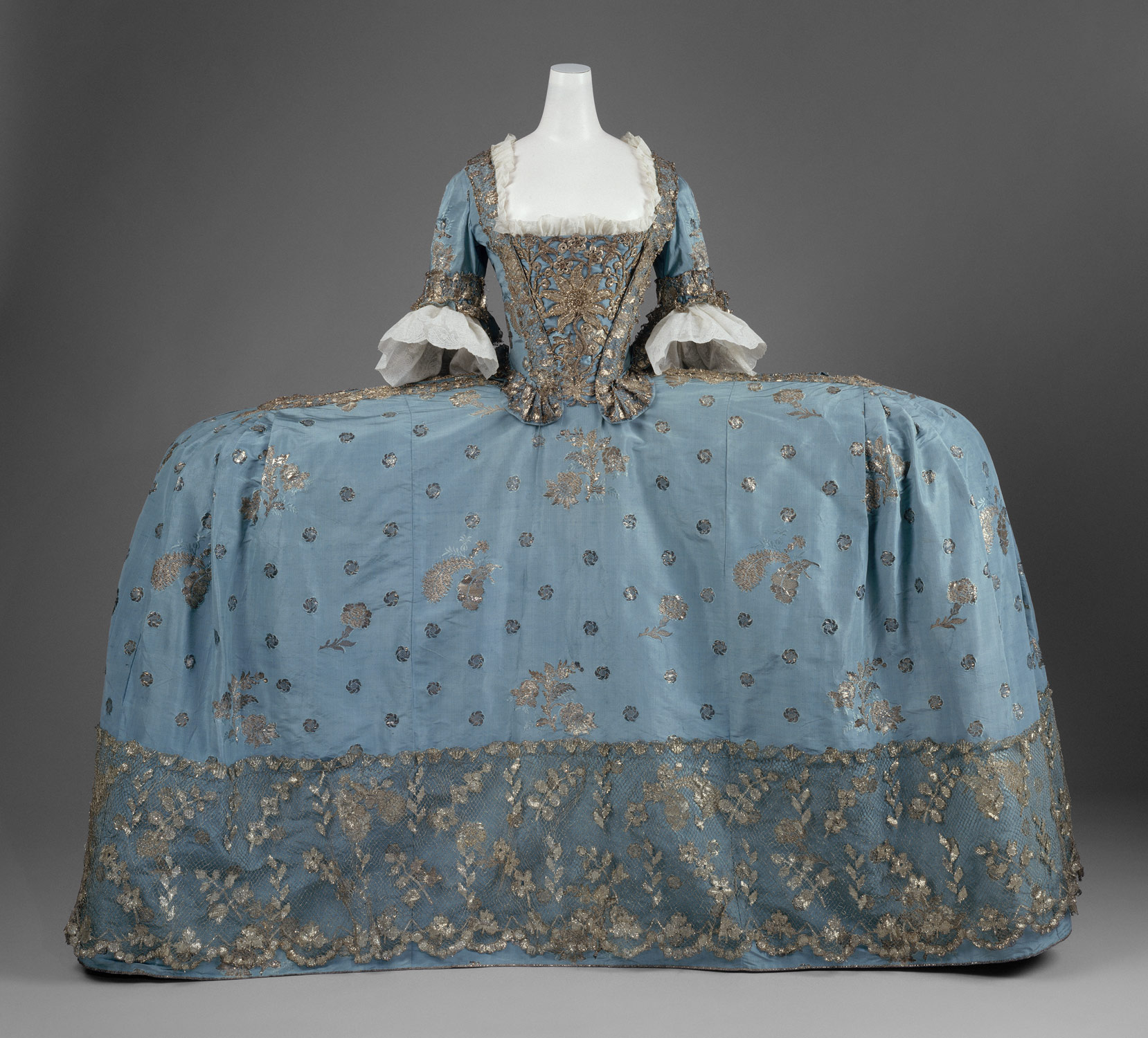 Working Title/Artist: Court dressDepartment: Costume InstituteCulture/Period/Location: HB/TOA Date Code: Working Date: 1750 Court dressca. 1750BritishBlue silk taffeta brocaded with silver threadPurchase, Irene Lewisohn Bequest, 1965 (C.I.65.13.1a–c) photography by mma, Digital File DT11837.tif retouched by film and media (jnc) 9_2_11