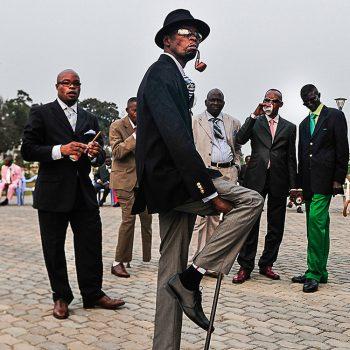 Daniele Tamagni: Sapeurs posing in front of Memorial Savorgnan de Brazz, Brazzaville, 2008